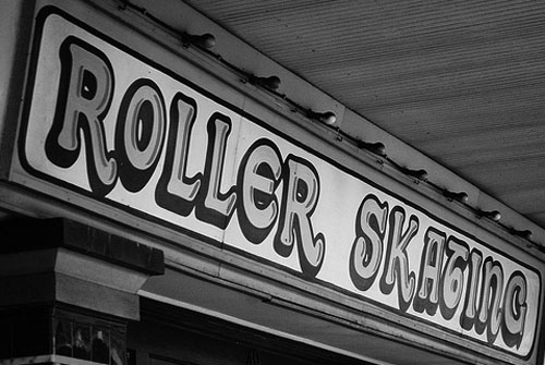 Roller skating join roller derby sign in black and white