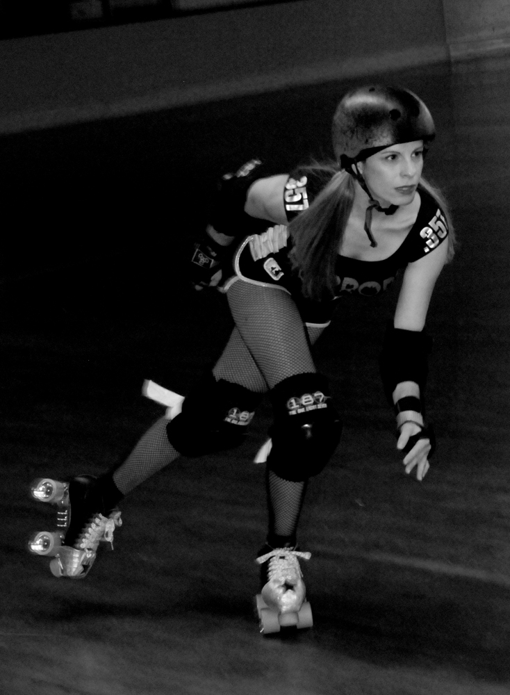 Puffy Bangs Roller Derby Skater Action Shot