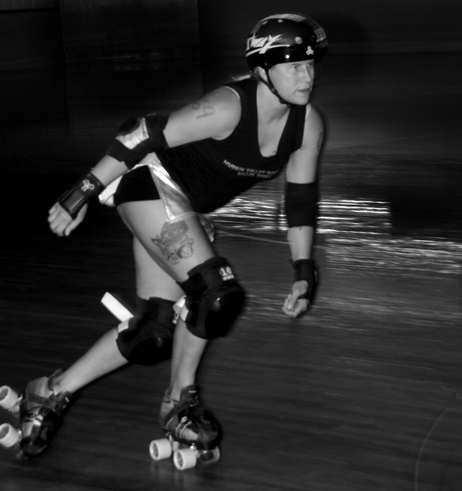 Slam'n Sway roller derby skater action shot
