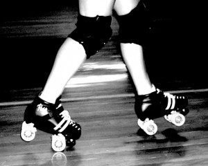 A roller derby skaters popping a wheelie